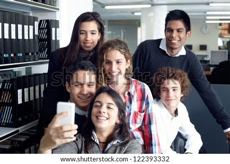 Group of teenagers taking a self portrait with smart phone - stock photo