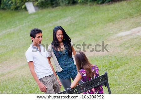 Group of Teenagers Talking at Park - stock photo