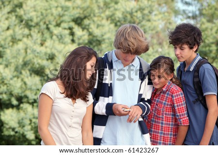 Group of teens after school - stock photo