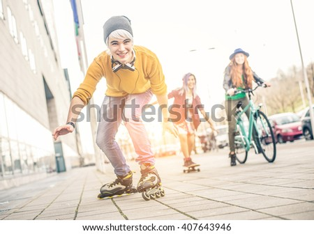 Group of teens making activities in an urban area, Concept about youth and friendship - Young friends having fun outdoors - stock photo