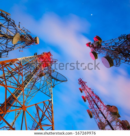 Group of Telecommunication towers at night - stock photo