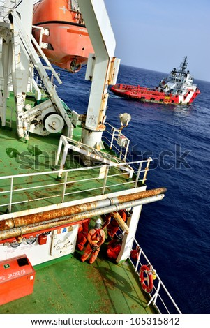 Group of the workers are waiting at offshore oil rig for supply boat in the gulf of thailand. - stock photo