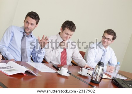 Group of three business men at the meeting - stock photo