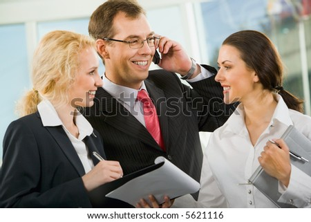 Group of three businesspeople are discussing important questions - stock photo