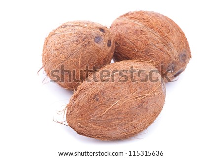 group of three coconuts on a white background - stock photo