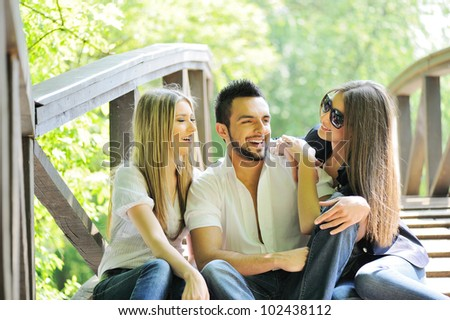 Group of three friends having fun - stock photo