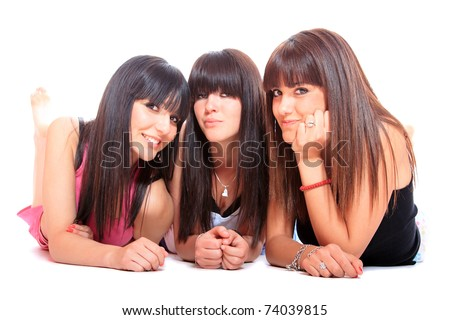 Group of three girls laying on the floor - stock photo
