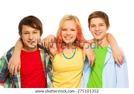 Group of three happy teens boys and girl hug - stock photo