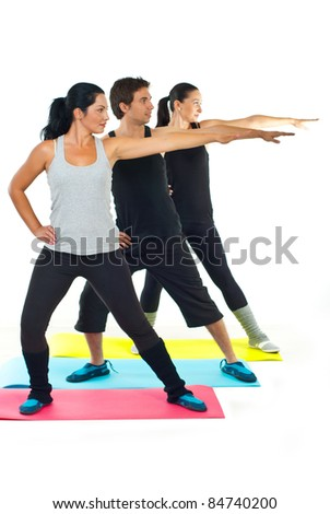 Group of three people doing fitness and lifting their arms - stock photo