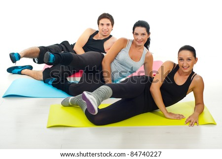 Group of three people doing  fitness exercises,selective focus on woman in gray shirt - stock photo