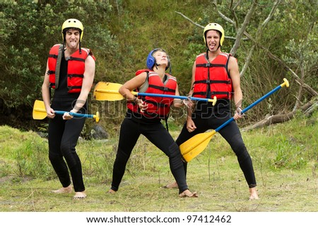 group of three rafters fooling around - stock photo