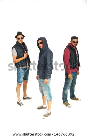 Group of three rappers men with sunglasses isolated on white background - stock photo