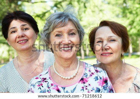 Group of three senior women looking at camera - stock photo