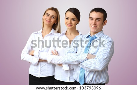 Group of three successful young business persons together