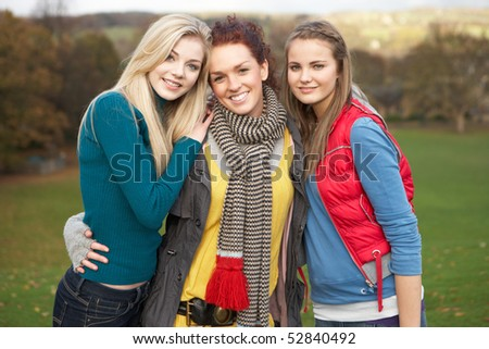 Group Of Three Teenage Female Friends In Autumn Landscape - stock photo