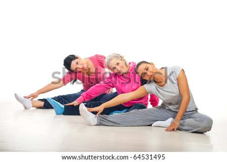 Group of three women training and stretching legs on florr over white background