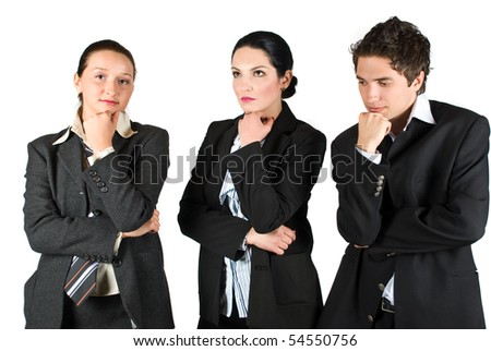 Group of three worried workers standing with hands crossed and thinking at future or  problems - stock photo