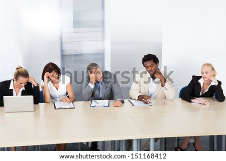 Group Of Tired Corporate Personnel Officers In A Row - stock photo