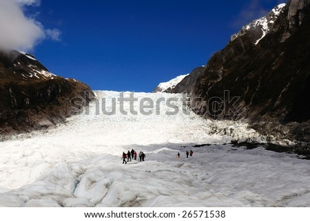 "Group of touring at ""Fox"" Glacier - South Island ""New Zealand"" - stock photo"