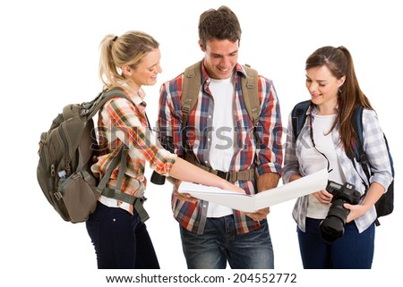 group of tourists checking directions on a map isolated on white background - stock photo