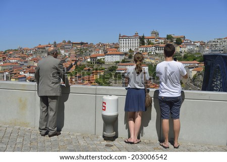 group of tourists enjoying the scenery of the city and its waterfront - stock photo