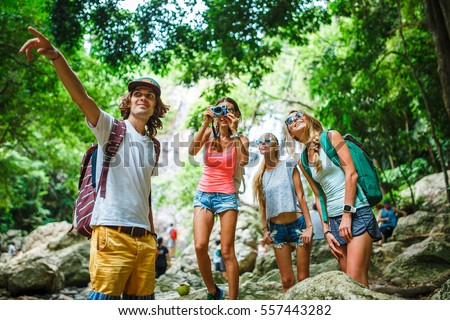group of tourists exploring jungle in thailand