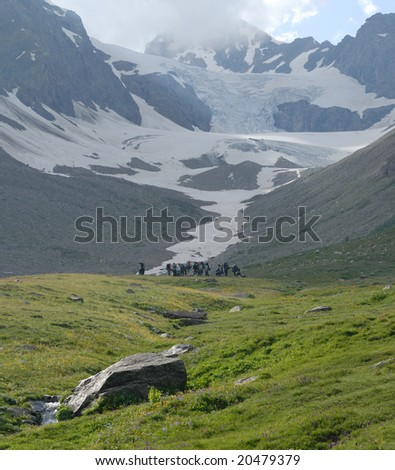 Group of tourists in highland of the Caucasus - stock photo