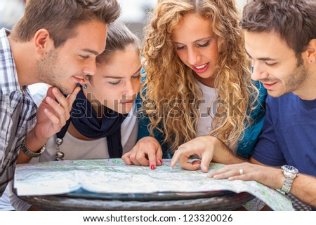 Group of Tourists Looking at Map