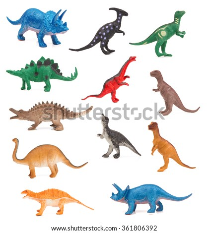 Group of toy dinosaurs on white background - stock photo