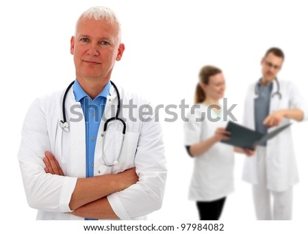 Group of tree doctors with European doctor - stock photo