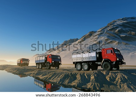 Group of trucks on the road in the mountains. - stock photo