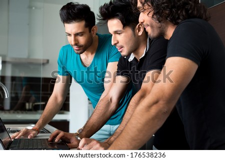 group of uni friends hanging out and using laptop. - stock photo