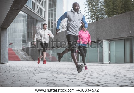 Group of urban runners making sport in an urban area - stock photo