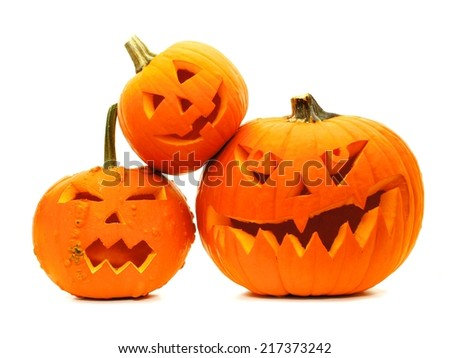 Group of varied Halloween Jack o Lanterns isolated on white - stock photo