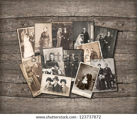 group of vintage family and wedding photos circa 1890-1920. nostalgic sentimental pictures on rustic wooden background - stock photo