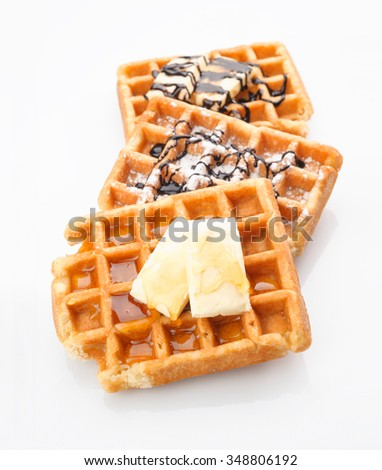group of waffles with honey butter and chocolate isolated on white - stock photo