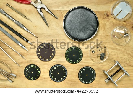 Group of  Watchmaker Tools on wood table , Upper view