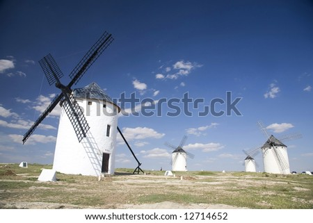 group of white mills in la mancha spain
