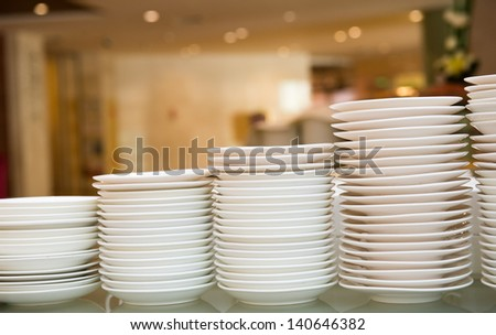 Group of white plates stacked together. - stock photo