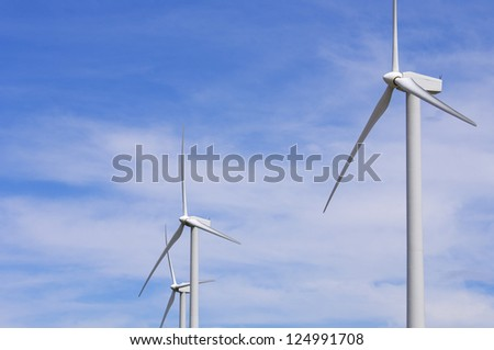 group of windmills for renewable electric energy production