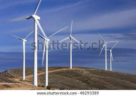 group of windmills with blue and clear sky - stock photo