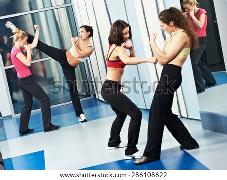 group of woman at fitness gym during martial art fighting physical training excercises thai bo - stock photo