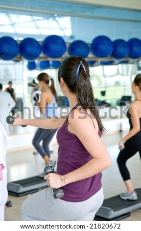 group of women at the gym doing aerobics - stock photo