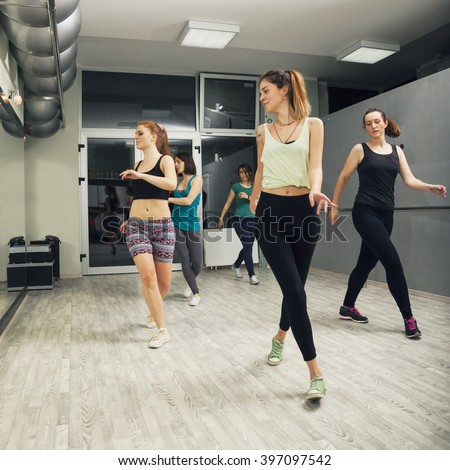 Group Of Women Exercising In Dance Studio - stock photo