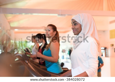 Group of Women Exercising in Gym - stock photo