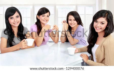 group of women friends having quality time together at home - stock photo