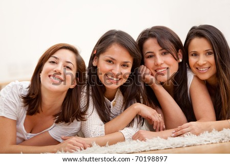 Group of women lying on the floor and smiling - stock photo