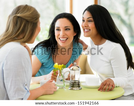 Group Of Women Meeting In Cafe - stock photo
