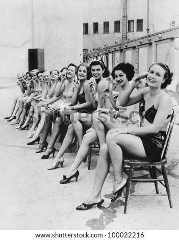 Group of women sitting together on chairs - stock photo