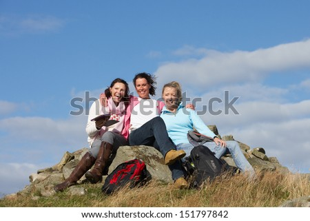Group Of Women Stopping For Lunch On Countryside Walk - stock photo